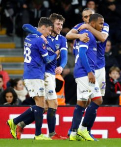 Oldham Athletic caused a major FA Cup third-round upset as they beat Premier League strugglers Fulham 2-1 at Craven Cottage.