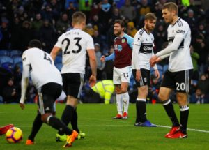 Burnley eased their relegation concerns after coming from behind to beat fellow strugglers Fulham 2-1 at a wet Turf Moor.