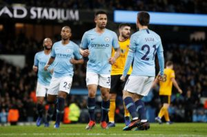 Manchester City moved back to within four points of Premier League leaders Liverpool with a 3-0 win against ten-man Wolves.