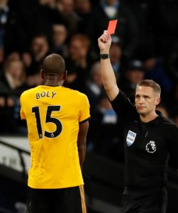 Wolves defender Willy Boly, who has started every Premier League game this season, will miss Saturday's clash with Leicester.
