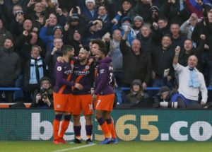 Manchester City moved back to within four points of Premier League leaders Liverpool with a 3-0 win at bottom club Huddersfield.