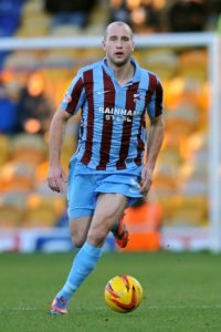 Mansfield defender David Mirfin has completed a loan move to York.