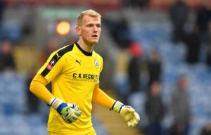 Adam Davies was the hero as his penalty save extended Barnsley's unbeaten run to 14 league matches after a goalless draw with Portsmouth at Fratton Park.
