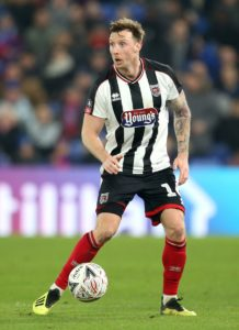 Grimsby are without suspended defender Ludvig Ohman for Saturday's visit of Cambridge in Sky Bet League Two.