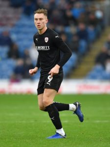 Cauley Woodrow scored both goals as Barnsley strengthened their grip on second spot in League One with a 2-1 win against Wycombe.