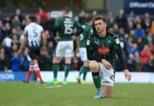 Graham Carey scored a superb free-kick to earn in-form Plymouth a 1-1 draw at home to Portsmouth in League One.