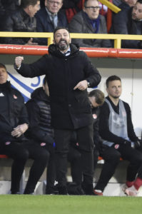 Aberdeen manager Derek McInnes admits he takes great pleasure in keeping pace with Rangers despite their major financial advantage.