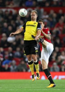 Luke Varney is a doubt for Cheltenham's Sky Bet League Two home clash with Port Vale on Saturday.