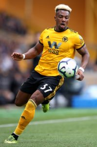 Wolves forward Adama Traore is confident he can improve further and says boss Nuno Espirito Santo sees him as a striker.