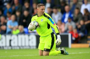 Tranmere had goalkeeper Scott Davies to thank as they held on for a goalless draw at Cambridge.