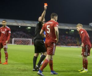 Aberdeen defender Scott McKenna is suspended for Sunday's William Hill Scottish Cup tie against Queen of the South after being sent off against Rangers.
