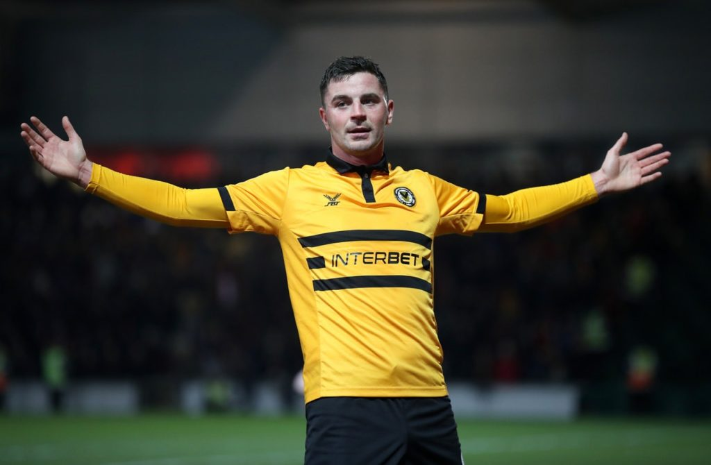 Newport striker Padraig Amond hopes the drinks are on him for a change as he attempts to add Manchester City to his list of FA Cup giant-killing victims.