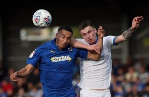 AFC Wimbledon boss Wally Downes might name an unchanged team against Burton.