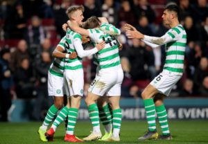 Neil Lennon began his second stint as Celtic boss with a dramatic last-gasp 2-1 Ladbrokes Premiership win over Hearts at Tynecastle.