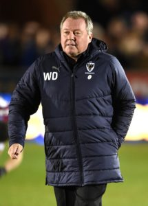AFC Wimbledon boss Wally Downes insisted his team will not suffer relegation without a fight despite a disappointing 2-0 defeat at home by Burton.