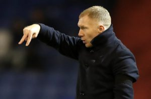 Paul Scholes suffered his first defeat in management as Oldham were stunned 2-1 at home by struggling Morecambe.