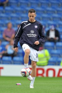 Carlisle will be without suspended midfielder Jamie Devitt when they host MK Dons on Saturday.