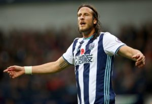 Wigan have signed former West Brom defender Jonas Olsson on a deal until the end of the season.