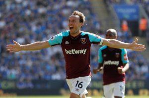 West Ham skipper Mark Noble is glad to see the back of a disruptive January and says results will come when the side gets settled again.
