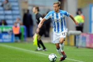 Huddersfield pair Chris Lowe and Jonas Lossl have returned to training as they look to build fitness ahead of the trip to Newcastle.