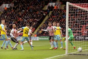 Sheffield United moved back into the Sky Bet Championship automatic promotion places as they beat 10-man Rotherham 2-0 at Bramall Lane.