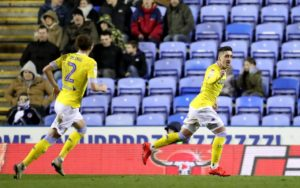 Leeds returned to the top of the Championship with a ruthless display of first-half finishing in their 3-0 victory at Reading.