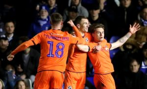 Ben Thompson's double at Birmingham gave Millwall a vital win in their fight against relegation.