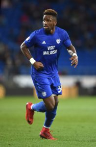 Cardiff City striker Omar Bogle has been granted permission to stay at Portsmouth for the play-offs if they qualify for them.