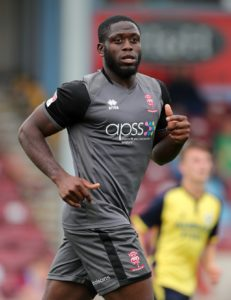 John Akinde's brace cemented Lincoln City's grip at the top of Sky Bet League Two as the Imps defeated Forest Green 2-1 at The New Lawn.