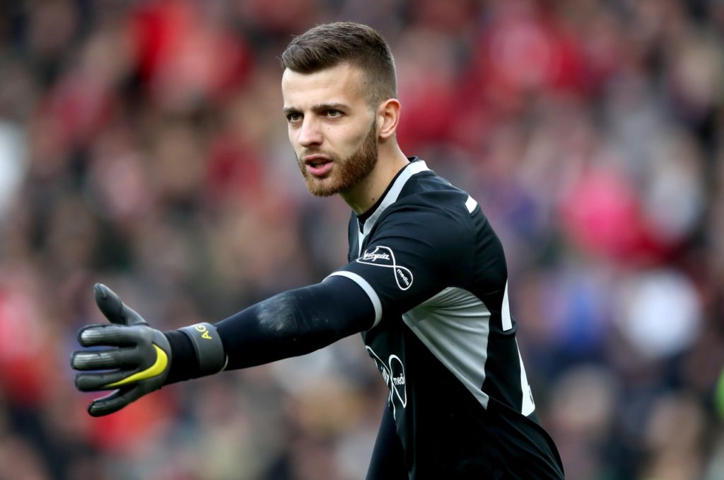 Scotland manager Alex McLeish admits he is in constant dialogue with Angus Gunn's father over the Southampton goalkeeper's international allegiance.