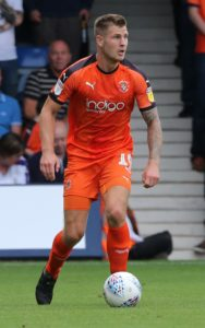 First-half goals from James Collins and Luke Berry proved enough for Luton to extend their lead at the top of League One with a 2-1 win at Bristol Rovers.