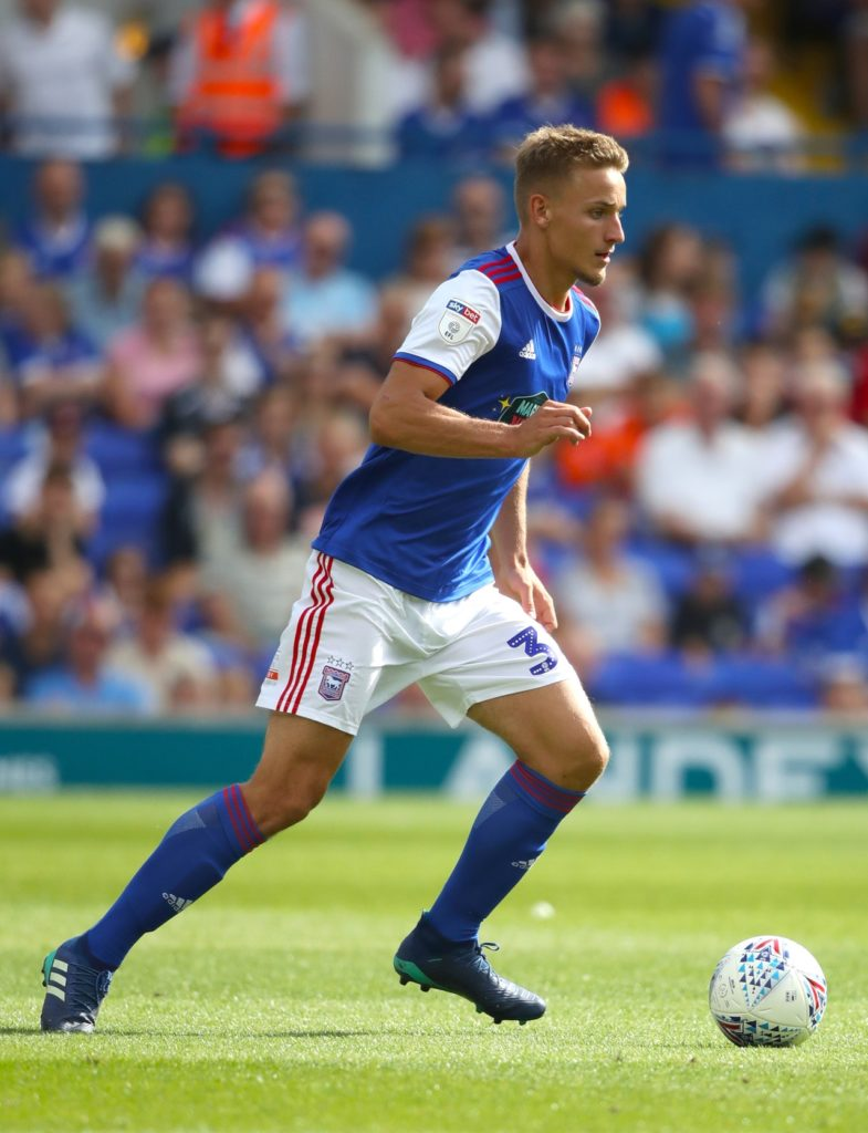 Goals from Canice Carroll, Luke Woolfenden and Kyle Bennett secured a convincing 3-0 win for Swindon against Colchester to keep their play-off hopes alive.