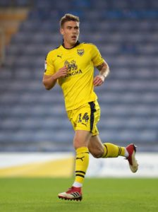 Josh Ruffels hit a stunning stoppage-time winner from 25 yards as Oxford came from behind to beat Wycombe 2-1 in an incident-packed derby.