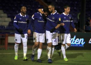 Oldham manager Paul Scholes will be without suspended midfielder Jose Baxter for the League Two clash with Tranmere at Boundary Park.