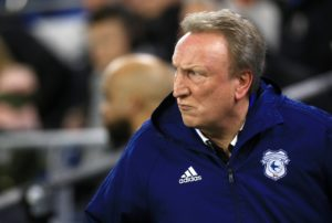 Cardiff City boss Neil Warnock says that fans who encroach onto the playing surface during games should be handed six months in jail.