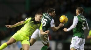 New interim Celtic boss Neil Lennon returned to Easter Road to knock his former club Hibernian out of the William Hill Scottish Cup with a 2-0 win.