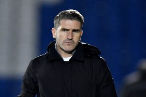 Bury manager Ryan Lowe insisted he was happy with his side's point at Grimsby, despite losing ground in the League Two title race.