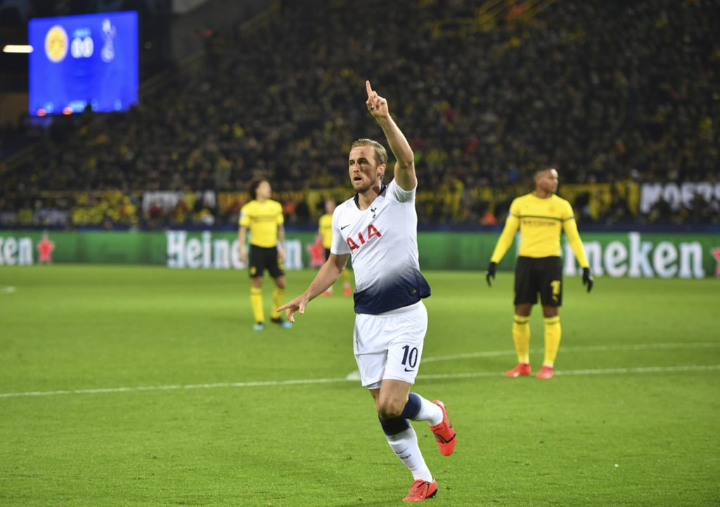 Harry Kane rewrote the history books as Tottenham finished off Borussia Dortmund to reach the Champions League quarter-finals.