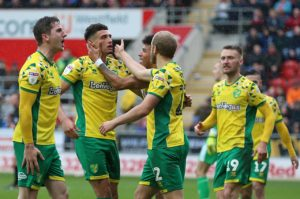 Table-topping Norwich made it six wins on the bounce as they beat Rotherham 2-1.