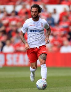Danny Fox and Anthony Pilkington are back in contention as Wigan host Brentford in the Sky Bet Championship.