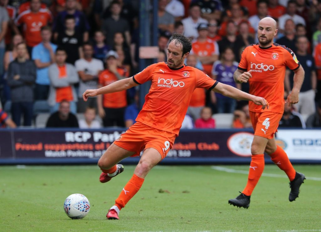 Strikers Danny Hylton and James Collins scored the goals as League One leaders Luton saw off struggling Rochdale 2-0.