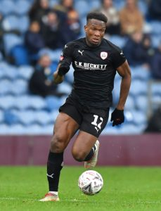 Dimitri Cavare's strike and an own-goal from Will Wood gave Barnsley a 2-0 victory over Accrington to maintain their push for automatic promotion.