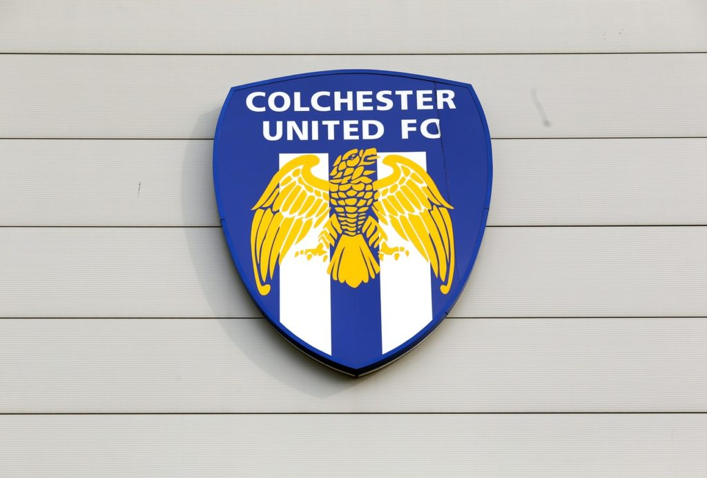 Colchester have vowed to take severe action against two fans who invaded the pitch during Tuesday night's home defeat to Forest Green.