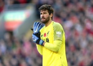 Liverpool goalkeeper Alisson says the current feel-good factor within the squad can help in their pursuit of Premier League glory.