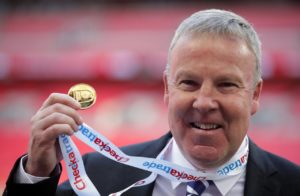 Portsmouth manager Kenny Jackett hailed the character of his players as they held their nerve in a penalty shootout to lift the Checkatrade Trophy.
