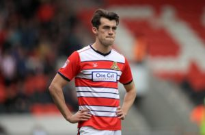 Doncaster striker John Marquis is back in contention for the home derby game against rivals Barnsley after suspension.