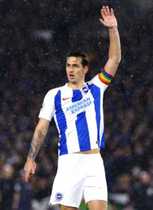 Chris Hughton has urged defender Lewis Dunk to fight his way back into the England squad by performing well for Brighton.