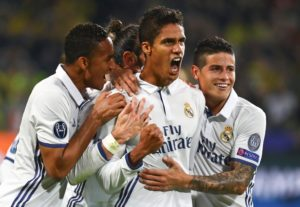 Real Madrid defender Raphael Varane insists he is happy at the club despite speculation linking him with a move to Manchester United.