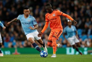 Lyon midfielder Pape Cheikh says he is happy he turned down the opportunity to join Tottenham to make the switch to the Ligue 1 side.