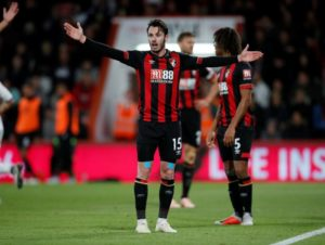 Bournemouth coach Eddie Howe insists he is happy to play the waiting game with Adam Smith after his latest injury setback.
